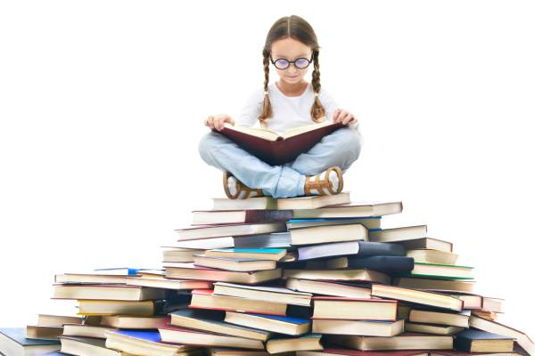 concentrated-girl-surrounded-by-books (1)